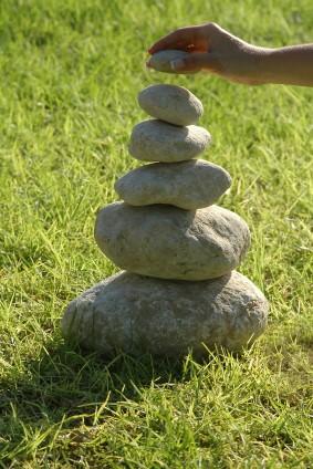 coach-stacking-rocks